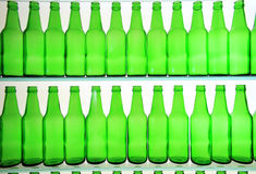 Bottles. The silhouette rows of the green bottles Stock Images