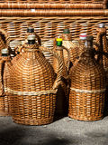 Bottles. Glass bottles protected with cane Stock Photo