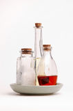 Bottles. Dish with bottles of oil and salt Royalty Free Stock Photos