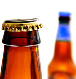 Bottles. Brown beer bottles with cap Royalty Free Stock Photography