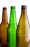 Bottles. Brown and Green bottles isolated on white stock image