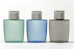 Bottles. Three bottles of lotion with different colors Stock Photos