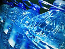 Bottles. Row of the bottled water in dark Royalty Free Stock Photography