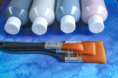Bottles with acrylic paint with brushes, handmade, hobby and decoration Royalty Free Stock Photos