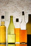 Bottles with alcohol Stock Images