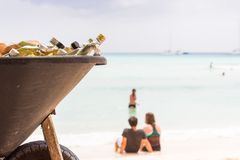 Bottles with alcohol for cocktails on the beach, Saona. Stock Images