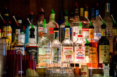 Bottles of alcohol on display at a bar Stock Image
