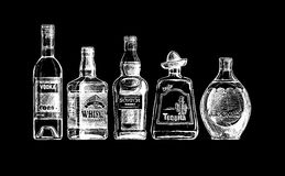Bottles of alcohol. Distilled beverage Royalty Free Stock Photo