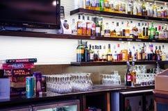 Bottles of alcohol in a finnish bar. Bottles with alcohol and display in a finnish bar Stock Image