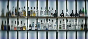 Bottles of Alcohol in a Bar. Bottles of alcohol lined up in bar Stock Images