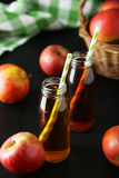 Bottles of apple juice Stock Images