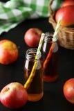 Bottles of apple juice Stock Images