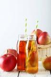 Bottles of apple juice Stock Image