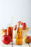 Bottles of apple juice Stock Photo