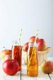 Bottles of apple juice Stock Photo