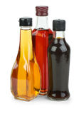 Bottles with apple and red wine. Vinegar and soy sauce  isolated on the white background Royalty Free Stock Photos