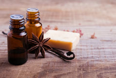 Bottles with aroma oil, vanilla pods and hand made soap Stock Image