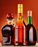 Bottles of assorted alcoholic beverages Stock Images