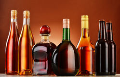 Bottles of assorted alcoholic beverages Stock Photos