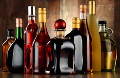 Bottles of assorted alcoholic beverages Royalty Free Stock Images