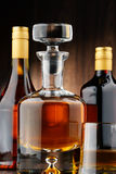 Bottles of assorted alcoholic beverages and glass of whisky Stock Photo