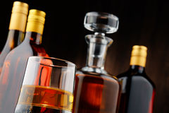 Bottles of assorted alcoholic beverages and glass of whisky Royalty Free Stock Image