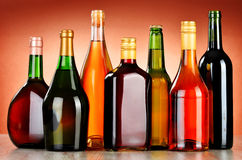 Bottles of assorted alcoholic beverages including beer and wine.  Stock Photos