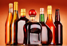 Bottles of assorted alcoholic beverages including beer and wine.  Royalty Free Stock Photo