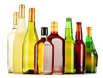 Bottles of assorted alcoholic beverages on white Stock Photography