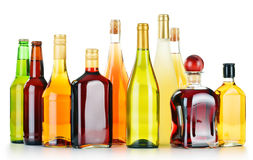 Bottles of assorted alcoholic beverages on white Royalty Free Stock Images
