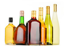 Bottles of assorted alcoholic beverages on white Stock Images