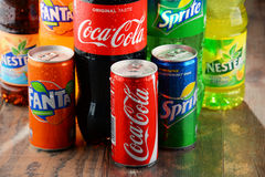 Bottles of assorted Coca Cola Company soft drinks Stock Photography