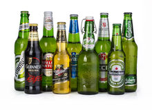 Bottles of assorted cold beers. Royalty Free Stock Images