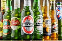 Bottles of assorted global beer brands Royalty Free Stock Images