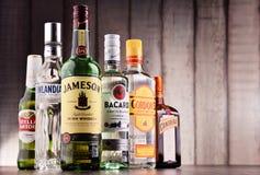 Bottles of assorted global hard liquor brands Stock Photo