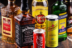 Bottles of assorted global hard liquor brands stock images