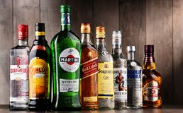 Bottles of assorted global liquor brands. POZNAN, POLAND - DEC 15, 2017: Bottles of assorted global liquor brands including Martini, Johnnie Walker, Captain stock photo