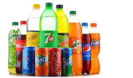 Bottles of assorted global soft drinks Stock Image