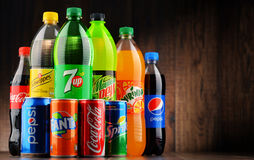 Bottles of assorted global soft drinks Stock Photography