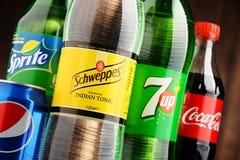Bottles of assorted global soft drinks Stock Image