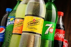 Bottles of assorted global soft drinks Stock Photo