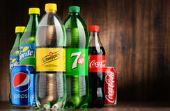 Bottles of assorted global soft drinks Stock Photos