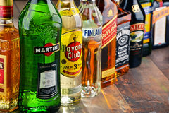 Bottles of assorted hard liquor brands Royalty Free Stock Photos