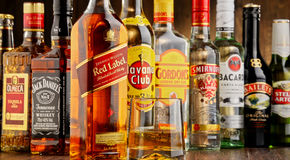 Bottles of assorted hard liquor brands Royalty Free Stock Images
