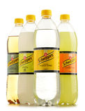 Bottles of assorted Schweppes drinks isolated on white Stock Image