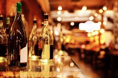 Bottles on the bar. On blurred background royalty free stock image