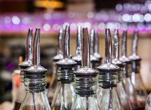 Bottles in bar with dispensers Royalty Free Stock Photography