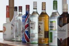 Bottles at a bar. A line of liquor bottles at a bar on a cruise ship Stock Photo