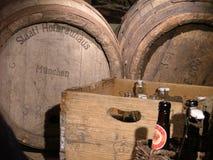 Bottles and barrels. Beer bottles and beer barrels Stock Images