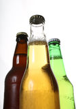 Bottles of beer. 3 different coloured bottles of beer Stock Photography